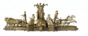 en 1871, lors de la Commune, le surtout  brûla dans l'incendie du palais des Tuileries. Henri Bouilhet, vice-président de la manufacture Christofle, le sauva des cendres et le donna au musée des Arts décoratifs.