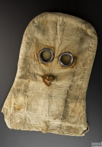 """Gas mask, helmet type, canvas with metal fittings and glass eyepieces, British, 1915"", digitised collections, Science Museum London, http://collectionsonline.nmsi.ac.uk/grabimg.php?wm=1&kv=182709"