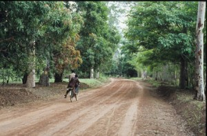 Couple cycling on the road between Yei and Meridi, Southern Sudan
