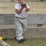 Enfant jouant aux boules bretonnes, photographie fournie par Jean-Paul Audic