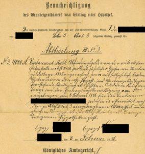 Grundschuldeintragung mit geschwärzten Namen (1886).