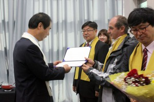 Satprem giving the diploma to a student December 2013