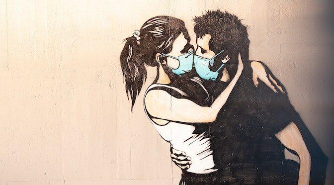 Tag d'une femme et d'un homme enlacés et masqués
