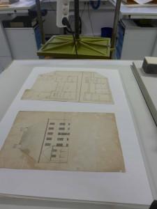 Symboldbild von Karten in Archivregalen