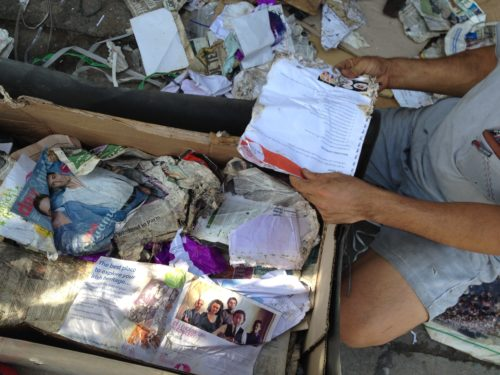 Trash-box full of degraded personal papers