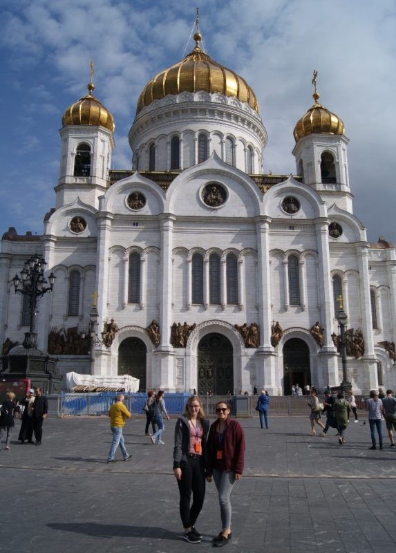 Photo: Two participants in front of the Cathedral of Christ the Saviour in Moscow.