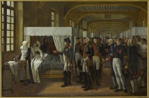Alexandre-Paul-Joseph Véron-Bellecourt, Napoléon visitant l'infirmerie des Invalides le 11 février 1808, 1809, huile sur toile, 183 x 248 cm, Versailles, châteaux de Versailles et de Trianon. © Château de Versailles
