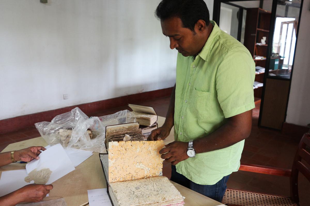 Examination of fumigated items (photo Udaya Cabral)