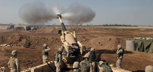 The US Marine Corps (USMC) M-198 155mm Howitzer gun crew of 4th Battalion, 14th Marines, Mike Battery, Gun 4, left to Right, Gunnery Sergeant (GYSGT) Justin Grafton, Cannoneer Private First Class (PFC) Matthew Camp, Section Chief Sergeant (SGT) Mike Dasher, Cannoneer Lance Corporal (LCPL) Josh Rosenberger, Cannoneer Corporal (CPL) Will McGee, Ammunition Team Chief CPL Jonathan Layman and Cannoneer LCPL Jonathan Fox.  Marines at Camp Fallujah, Iraq (IRQ), engage enemy targets in support of Operation IRAQI FREEDOM. This picture is in public domain, property of the U.S. federal government