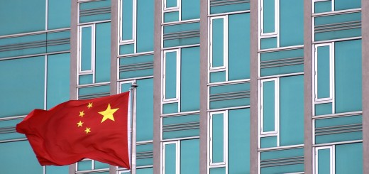 Chinese flag with modern office building. The picture was taken