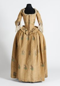 Dress (front view), yellow moiré silk, 1730-1740. Mexico, National History Museum (MNH). Photograph by Omar Dumaine