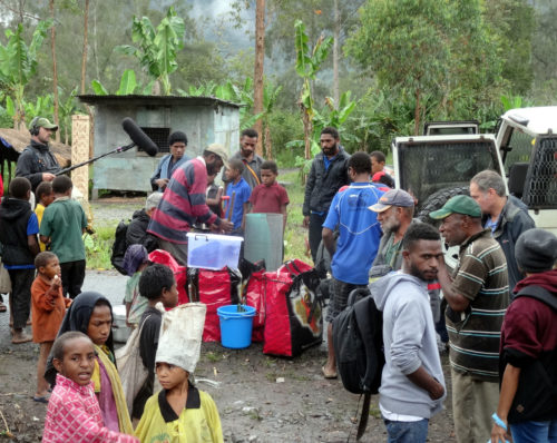 The TV crew shooting at Poga village while the team was preparing the field equipment.