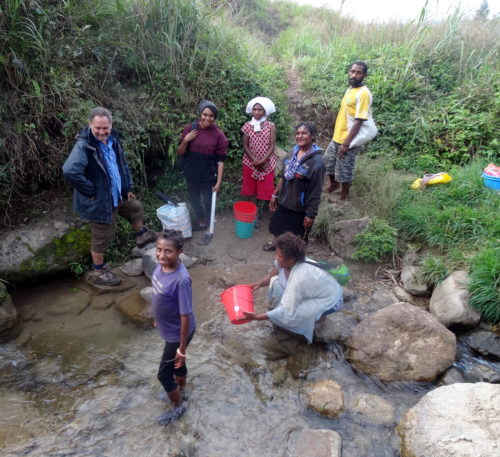 Daily cleaning at the Rungen creek on the way back to Manim village.