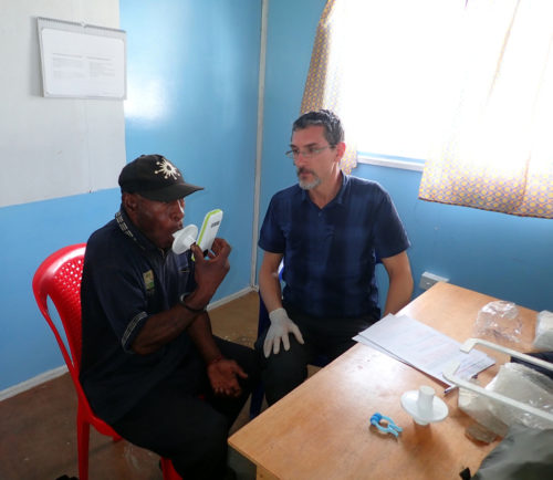 F.-X. Ricaut with a participant from St Therese's School at Denglagu mission, recording lung capacity.