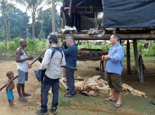 M. Leavesley and the TV crew in action at Awim village.