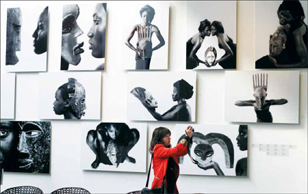 Masks are more than decoration in African culture. Africans adore and respect masks. On the wall are Essamba's Woman and Mask series. Wang Jing / China Daily