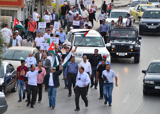 Demonstrators march in west Amman on Sunday in protest against the government's recent decision to raise fuel and electricity prices (Photo by Muath Freij) (Jordan Times, 27 may 2012)