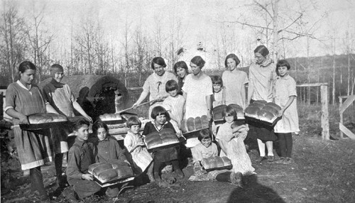 Photo of girls with bread at Kolokreeka School, Smoky Lake, circa 1930