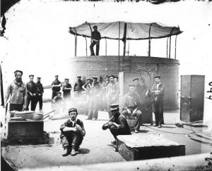 USS Monitor crewmembers cooking on deck, in the James River, Virginia, 9 July 1862. Photographed by James F. Gibson, courtesy of Wikipedia.