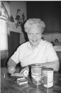 """""""Elaine Marken using a slate and stylus to create Braille labels for canned foods,"""" http://www.iowablindhistory.org/blindhistory/household-tasks. """"Courtesy of Iowa Blind History Archive at the Iowa Department for the Blind."""""""