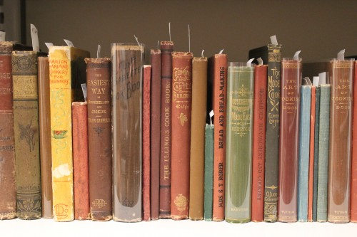 A shelf view of the Esta Kramer Collection of American Cookery at Bowdoin College Library.