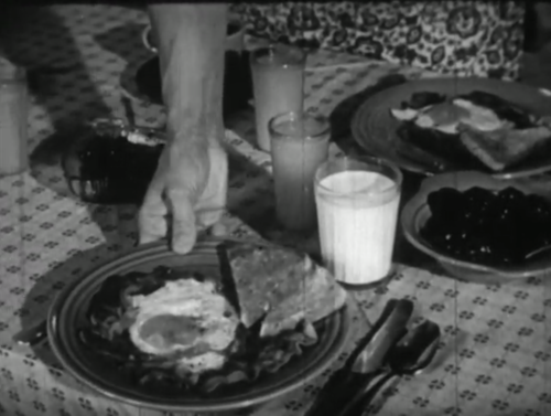 Art's mother brings breakfast to the table. Image credit: The Internet Archive, A/V Geeks Collection.