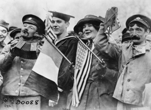 An American sailor, an American Red Cross Nurse and two British soldiers celebrating the signing of the Armistice, near the Paris Gate at Vincennes, Paris | This is photograph Q 65857 from the collections of the Imperial War Museums | Public Domain